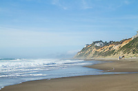 People walking on the beach at Nelscott Reef in  Lincoln City, OR.