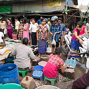 A busy scene at the fish and flower market in Mandalay, Myanmar (Burma).