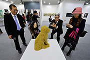 HONG KONG - MARCH 13:  Visitors react to sculpture 'Royal Pet' by Troy Emery in art fair Art Central on its first day on March 13, 2015 in Hong Kong, Hong Kong.  (Photo by Lucas Schifres/Getty Images)