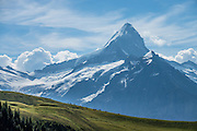 Schreckhorn rises impressively above Grindelwald, in Switzerland, the Alps, Europe. The Schreckhorn (4078 m / 13,379 ft) is the northernmost summit rising above 4000 meters in Europe. This whole massif and surrounding glaciers were designated as part of UNESCO's Jungfrau-Aletsch World Heritage Site.