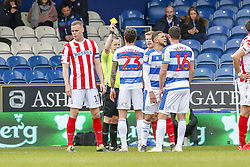 March 9, 2019 - London, England, United Kingdom - Referee Gavin Ward shows a yellow card to Queens Park Rangers PaweÅ' WszoÅ'ek during the first half of the Sky Bet Championship match between Queens Park Rangers and Stoke City at Loftus Road Stadium, London on Saturday 9th March 2019. (Credit Image: © Mi News/NurPhoto via ZUMA Press)