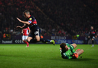 Football - 2018 / 2019 EFL Sky Bet League One - Play-Off Semi-Final, Second Leg: Charlton Athletic (2) vs. Doncaster Rovers (1)<br /> <br /> Charlton Athletic's Dillon Phillips beats Doncaster Rovers' Tommy Rowe to the ball, at The Valley.<br /> <br /> COLORSPORT/ASHLEY WESTERN