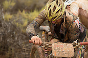 Douglas Brown and Barti Bucher of team Meerendal Songo Specialized, victims of the bad weather, repair a puncture during stage 2 of the 2014 Absa Cape Epic Mountain Bike stage race from Arabella Wines in Robertson, South Africa on the 25 March 2014<br /> <br /> Photo by Greg Beadle/Cape Epic/SPORTZPICS