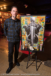 Artist Christopher Galley of Devil Chicken with one of the paintings he displayed at the Mama Tried Show. Milwaukee, WI. USA. Sunday February 25, 2018. Photography ©2018 Michael Lichter.