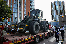 Metropolitan Police officers monitor a small convoy of vehicles approaching ExCeL London during preparations for the DSEI 2021 arms fair on 6th September 2021 in London, United Kingdom. The first day of week-long Stop The Arms Fair protests outside the venue for one of the world's largest arms fairs was hosted by activists calling for a ban on UK arms exports to Israel.