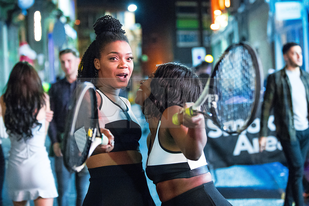 © Licensed to London News Pictures . 27/12/2017. Wigan, UK. Venus and Serena Williams . Revellers in Wigan enjoy Boxing Day drinks and clubbing in Wigan Wallgate . In recent years a tradition has been established in which people go out wearing fancy-dress costumes on Boxing Day night . Photo credit: Joel Goodman/LNP