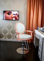 A video screen behind a makeup station at Blushington in Woodland Hills, CA.  November 9, 2015. Photo by David Sprague