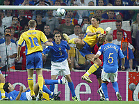Fotball<br /> Euro 2004<br /> 18.06.2004<br /> Sverige v Italia 1-1<br /> Foto: SBI/Digitalsport<br /> NORWAY ONLY<br /> <br /> Sweden's Zlatan Ibrahimovic flicks the ball with his heel to score in the top corner, past Italy's diving goalkeeper Gianluigi Buffon (r) and Christian Vieri standing covering the goal line