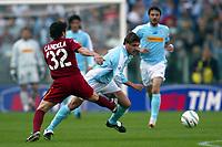 Roma 21/4/2004 Campionato Italiano Serie A <br />Lazio - Roma 1-1 <br />Vincent Candela (Roma) and Roberto Muzzi (Lazio)<br />Lazio and Roma are playing again after it was suspended on March 21, 2004, for security reasons.  <br />Foto Andrea Staccioli Graffiti