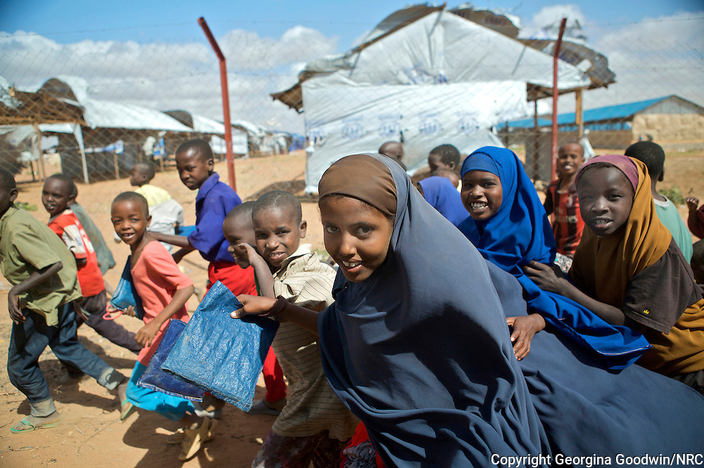 In one of the largest and oldest refugee settlements in the world, education in Dadaab is a luxury denied most of the 90,739 children who live there. Set up at the outset of Somalia's civil war in 1991 to accommodate 90,000 refugees, three camps near the northeastern Kenyan town of Dadaab  Hagadera, Ifo and Dagahaley  are now home to more than three times that number, and persistent conflict in Somalia, from where 95 percent of the refugees originate, means the population grows daily. According to the UN Children's Fund (UNICEF), the primary school attendance rate is 43 percent while in secondary schools the rate is just 12 percent. Across the three camps, there are 19 primary schools, funded by the UN Refugee Agency (UNHCR). In addition there are 11 private, fee-paying primary and six secondary schools. Here children from a UNHCR school are in need of more funding in Ifo refugee camp, Dadaab. 28May12