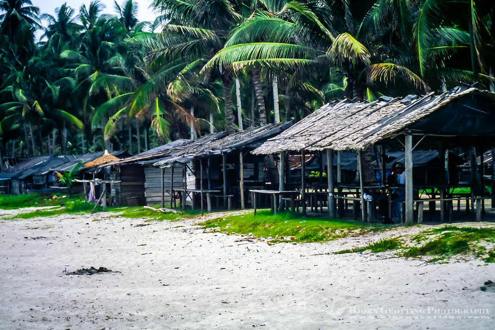 Riau Islands, Bintan. Trikora Beach. These half open huts work both as shelter and foodstalls.