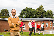 Richard of Lymm Community Energy in the playground of Ravenbank county primary school. Lymm Community Energy has a number of solar panels on top of Ravenbank county primary school.