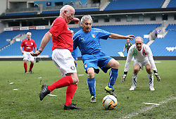 England's Tommy Charlton (left) challenges Italy's Giuliano Pittarella on his England debut during the Walking Football International match at The AMEX Stadium, Brighton.