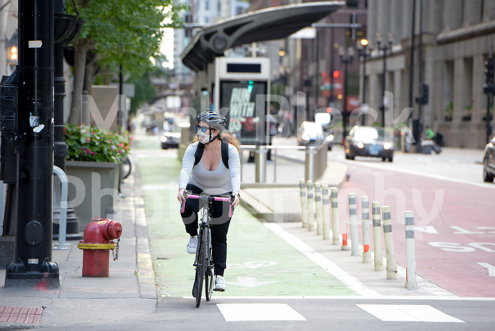 Cyclist in a bike lane in downtown Chicago, Illinois. Photo by Mark Black