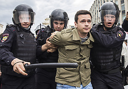 June 12, 2017 - Moscow, RUSSIA - Police detain Russian opposition activist Ilya Yashin In Moscow, Russia, Monday, June 12, 2017. Demonstrators in Monday's opposition protests across Russia say they are fed up with endemic corruption among officials. Demonstrators in Monday's opposition protests across Russia say they are fed up with endemic corruption among officials. The protest gatherings in cities from Far East Pacific ports to St. Petersburg were spearheaded by Alexei Navalny, the anti-corruption campaigner who has become the Kremlin's most visible opponent. (Credit Image: © Prensa Internacional via ZUMA Wire)