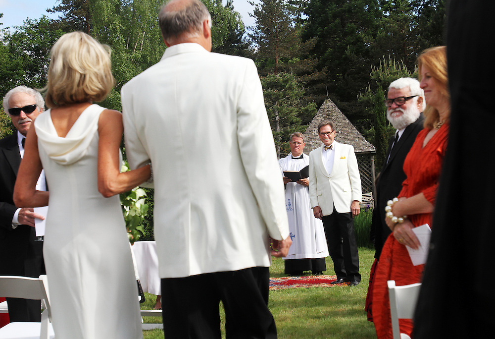 F. Timothy Nagler watches as Nancy Coffey walks down the aisle toward him at Duckridge Farm in Portland, Ore., Saturday, June 2, 2012...The bride, 66, is a Senior Vice President with The Corcoran Group in New York.  She graduated from Stanford and received a M.S. in Engineering from Stanford. She is a daughter of Joan Moore of Montecito, Ca., and the late Arthur J. Coffey, a custom home builder and developer in Palm Springs, Ca., where she grew up...The bridegroom, 65, is the president and owner of Jungclaus-Campbell Co., Inc., an Indianapolis industrial general contractor founded in 1875.  He graduated from Carleton College and received a M.A. in English from the University of Virginia.He is the son of Ruth E. and Louis G. Nagler of Amery, Wisconsin.  His father was a lawyer, his mother a homemaker.