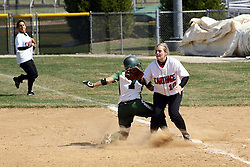 05 April 2008: Monica Urban hustles back to 1st on a pick off play while Jacquelyn Tassone waits for the throw. The Carthage College Lady Reds lost the first game of this double header to the Titans of Illinois Wesleyan 4-1 at Illinois Wesleyan in Bloomington, IL