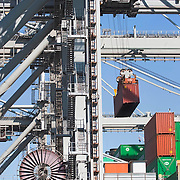 Nederland Zuid-Holland Rotterdam  27-08-2009 20090827 Foto: David Rozing .Serie over logistieke sector.ECT Delta terminal in de haven van Rotterdam. Kranen tillen de containers op een zeeschip. .ECT,European Container Terminals, at the Port of Rotterdam. Europe's biggest and most advanced container terminal operator, handling close to three- quarters of all containers passing through the Port of Rotterdam. ECT is a member of the Hutchison Port Holdings group (HPH), the world biggest container stevedore with terminals on every Continent. . In the stack, unmanned automated stacking cranes ( ASCs ) ensure that the containers are always stacked in the correct place. Terminal operations are highly automated for discharging and loading large volumes...Holland, The Netherlands, dutch, Pays Bas, Europe .Foto: David Rozing