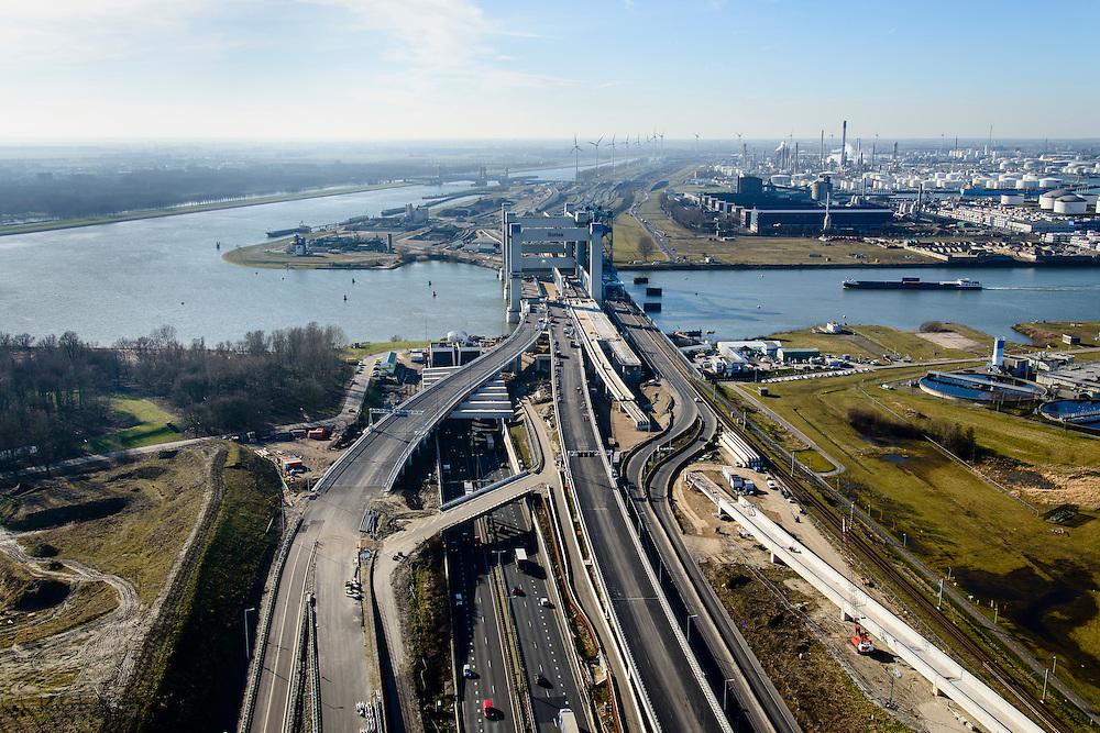 Nederland, Zuid-Holland, Rotterdam, 18-02-2015; oostelijke toerit Botlektunnel onder de Oude Maas, gezien naar de nieuwe Botlekbrug  (in aanbouw).<br /> Eastern entrance Botlektunnel under the Old Meuse and the new Botlek bridge (under construction). <br /> luchtfoto (toeslag op standard tarieven);<br /> aerial photo (additional fee required);<br /> copyright foto/photo Siebe Swart
