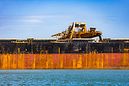 Iron ore is loaded onto an ore carrier at Port Hedland in Western Australia for export.