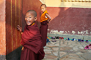 Playing after lunch break - Tsoknyi nunnery, Kathmandu, Nepal, 2014