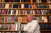 Surrounded by books is British Roman Catholic journalist, historian, speechwriter and author, Paul Johnson portrait at home. Paul Bede Johnson (born 2 November 1928) is an English journalist, historian, speechwriter and author. He was educated at the Jesuit independent school Stonyhurst College, and at Magdalen College, Oxford. Johnson first came to prominence in the 1950s as a journalist writing for, and later editing, the New Statesman magazine. A prolific writer, he has written over 40 books and contributed to numerous magazines and newspapers. While associated with the left in his early career, he is now a conservative popular historian. His sons are the journalist Daniel Johnson, founder of Standpoint, and the businessman Luke Johnson, former chairman of Channel 4.