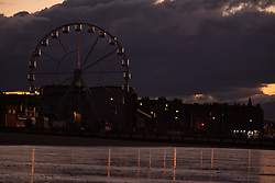 Following today's news from the council that the Ferris Wheel will be able to operate under the temporary license now that the Scottish COVID restrictions on funfair rides are to be relaxed the wheel looked spectular against tonight's sunset © Jon Davey/ EEm