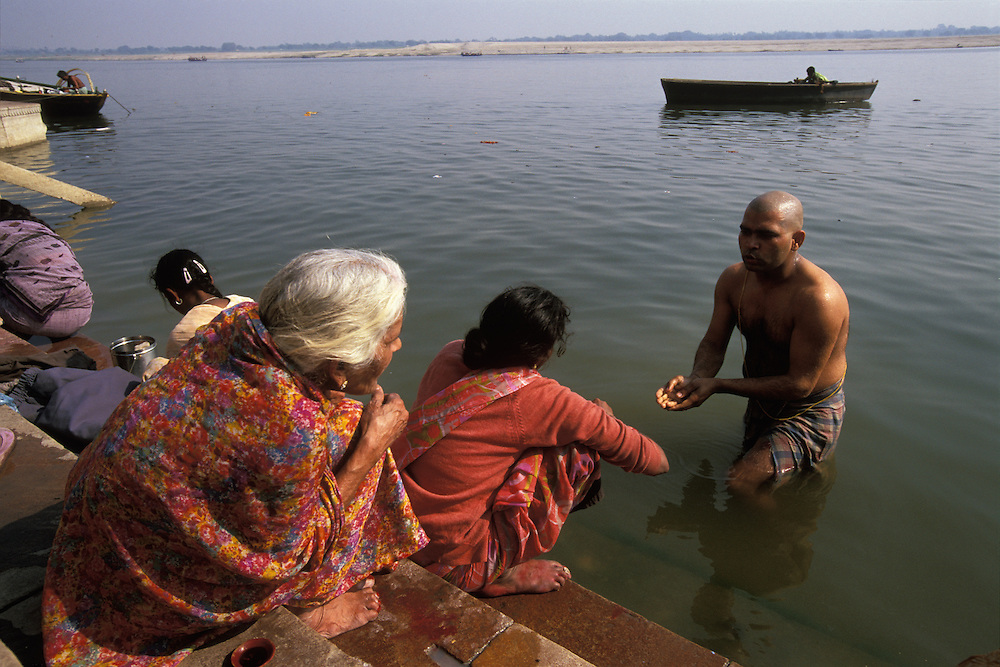 Mourners return to the river Ganges for a purification rited ten days after the cremation in Varanasi, India