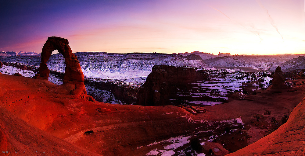 Alpenglow on Delicate Arch in Arches National Park.  We missed the actual sunset and got a lot of smug looks from the other tripod bearors who proceeded to leave...but the real color came about 20 minutes later as we were kicking ourselves for missing sunset, and getting ready to go.  The good light crept up on us and everything began to glow, and for 5 minutes, give or take, we had spectacular color.  It's about a mile walk back down the slickrock to your vehicle, and a bit hairy in January.  My brother went over the side on the icy shelf leading down the backside of this bowl, and luckily managed to catch himself before a drop of a good 20 feet or so that might have been disastrous.  The cold didn't bother us much, as our adrenalin by that point was running pretty high.