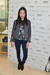 Model VANESSA LEE at a party to celebrate the launch of French Connection's #CANTHELPMYSELFIE -The UK's first in-store interactive selfie booths and windows held at French Connection, 249-251 Regent Street, London on 15th April 2014.