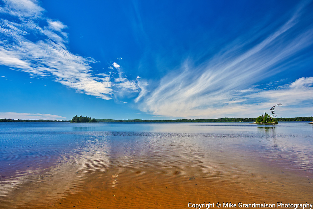 Clouds reflected in Lac-aux-Sables<br />Belleterre<br />Quebec<br />Canada
