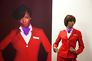 The famous red uniform on a mannequin. Virgin Atlantic air stewardess and steward training at The Base training facility in Crawley. Potential hostesses are put through a gruelling 6 week training program, during which they are tested to their limits. With exams every day requiring an 88% score to pass. The Base is a modern environment for a state of the art airline training situated next to Virgin Atlantic's HQ.