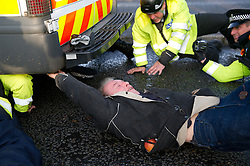© under license to London News Pictures. 01/11/2010. Protesters outside Devonport dockyards, protesting against the refitting of subs and the Trident Weapon System, attempting to disrupt the flow of traffic in and out of the base. Protesters bound themselves together using piping and super-glue. .