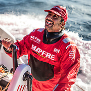Leg 7 from Auckland to Itajai, day 02 on board MAPFRE. Guillermo Altadill at the front pedestal talking with Xabi. 19 March, 2018.