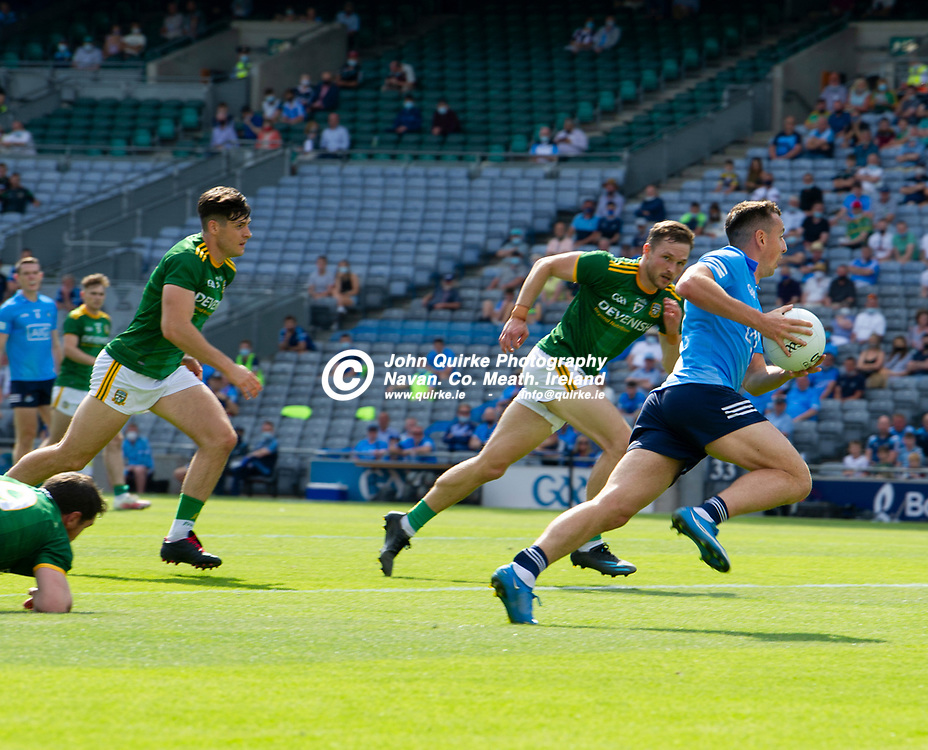 18-07-21. Meath v Dublin - Leinster SFC Semi-Final at Croke Park.<br /> Cormac Costello bursting forward for Dublin with Conor McGill, Meath closing in.<br /> Photo: John Quirke / www.quirke.ie<br /> ©John Quirke Photography, 16 Proudstown Road, Navan. Co. Meath. (info@quirke.ie / 046-9028461 / 087-2579454).