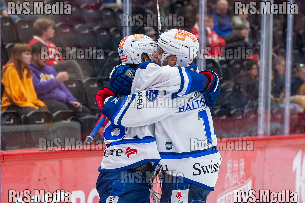 LAUSANNE, SWITZERLAND - OCTOBER 01: Dario Trutmann #86 of ZSC Lions celebrates his goal with Chris Baltisberger #14 of ZSC Lions during the Swiss National League game between Lausanne HC and ZSC Lions at Vaudoise Arena on October 1, 2021 in Lausanne, Switzerland. (Photo by Monika Majer/RvS.Media)