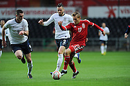 George Williams of Wales (17) looks to go Past England's Carl Jenkinson (2) and Michael Keane (5) UEFA 2015 European U21 championship, group one qualifier , Wales u21 v England u21 at the Liberty Stadium in Swansea, South Wales on Monday 19th May 2014. <br /> pic by Andrew Orchard, Andrew Orchard sports photography.
