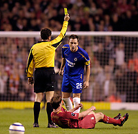 Photo: Jed Wee, Digitalsport<br /> Liverpool v Chelsea. UEFA Champions League.<br /> 28/09/2005.<br /> <br /> Chelsea's John Terry continues to have a go at Liverpool's Xabi Alonso despite being shown the yellow card by referee Massimo de Santis for his challenge on the Liverpool midfielder.