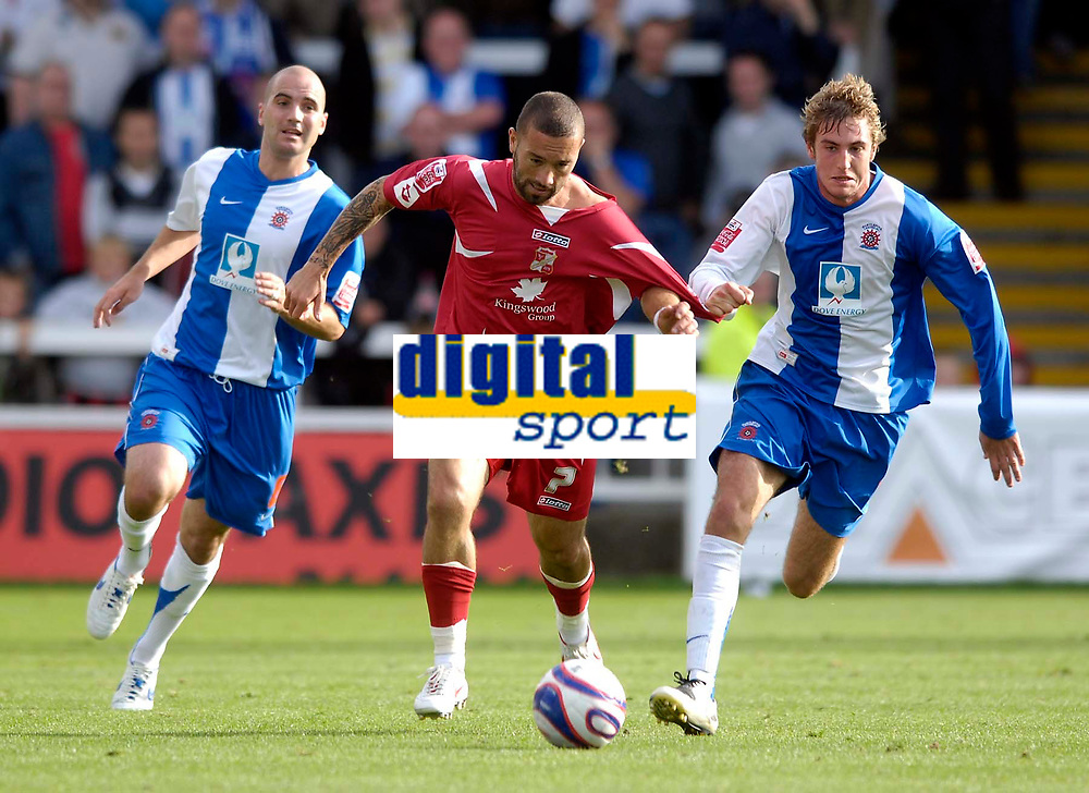 Photo: Jed Wee/Sportsbeat Images.<br /> Hartlepool United v Swindon Town. Coca Cola League 1. 15/09/2007.<br /> <br /> Swindon's Christian Roberts (C) tries to get beyond Hartlepool's Gary Liddle (R) and Ben Clark.