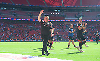 Lincoln City's assistant manager David Kerslake waves to the fans at the final whistle<br /> <br /> Photographer Chris Vaughan/CameraSport<br /> <br /> The EFL Sky Bet League One Play-Off Final - Blackpool v Lincoln City - Sunday 30th May 2021 - Wembley Stadium - London<br /> <br /> World Copyright © 2021 CameraSport. All rights reserved. 43 Linden Ave. Countesthorpe. Leicester. England. LE8 5PG - Tel: +44 (0) 116 277 4147 - admin@camerasport.com - www.camerasport.com
