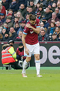 West Ham United forward Andy Carroll (9) holds his shoulder during the The FA Cup 3rd round match between West Ham United and Birmingham City at the London Stadium, London, England on 5 January 2019.