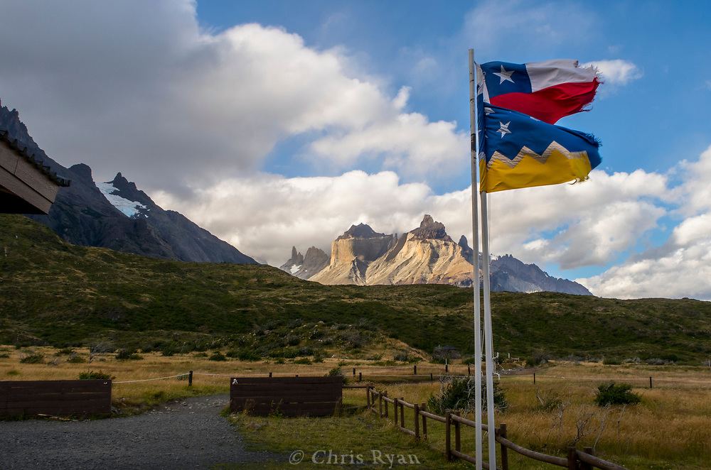 Flags at Refugio Paine Grande, view to Torres del Paine, Patagonia