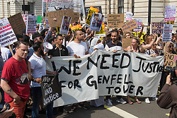 London, June 21st 2017. Protesters march through London from Sheherd's Bush Green in what the organisers call 'A Day Of Rage' in the wake of the Grenfell Tower fire disaster. The march is organised by the Movement for Justice By Any Means Necessary and coincides with the Queen's Speech at Parliament, the destination. PICTURED: The crowd marches down Whitehall towards Downing Street and Parliament Square beyond.