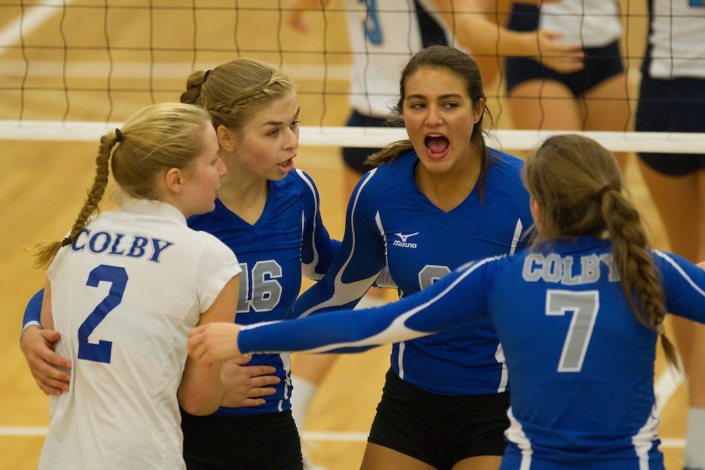 Karolina Serhan and Sarah Arvidson, of Colby College, during an NCAA Division III volleyball match against Connecticut College at The Whitmore-Mitchell at Wadsworth Gymnasium, Saturday Sep. 20, 2014 in Waterville, ME.  (Dustin Satloff/Colby College Athletics)