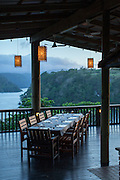 Table setting a Tufi Lodge and view from Tufi Lodge, Tufi, Cape Nelson, Oro Province, Papua New Guinea