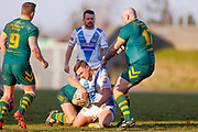 Workington Town stand off Jamie Doran (6) is stopped by Hunslet Club Parkside interchange Adam Biscomb (17)  during the Ladbrokes Challenge Cup round 3 match between Hunslet Club Parkside and Workington Town at South Leeds Stadium, Leeds, United Kingdom on 24 February 2018. Picture by Simon Davies.