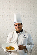 Head chef at the Park Hotel, Anurudh Khanna with  a dish of shahi paneer in the restaurant, New Delhi, India.