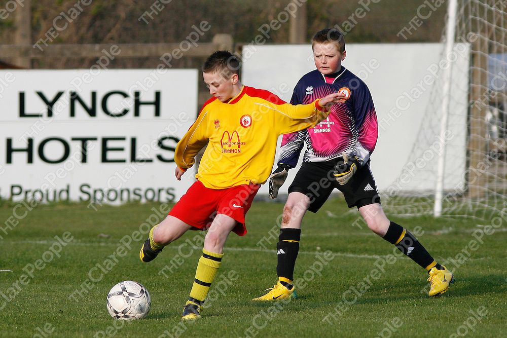 Avenue's Billy Slattery comes to the rescue of hie keeper Kevin Barron to clear the danger.<br />Photograph by Flann Howard