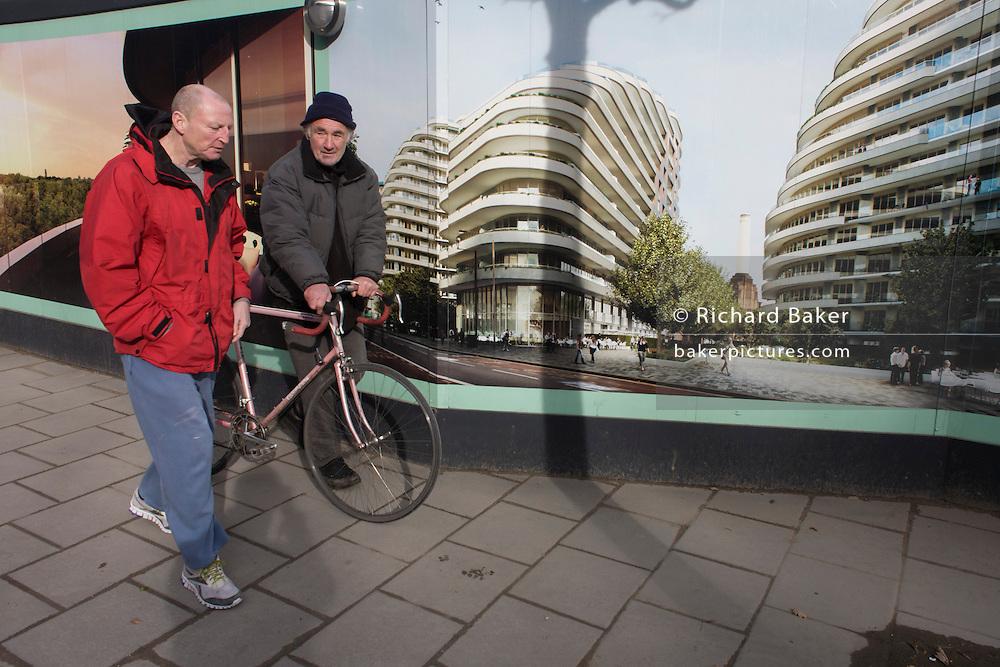 Locals walk past unaffordable housing development hoarding in Battersea, south London.