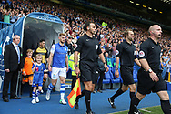 referee Simon Hooper and Sheffield Wednesday defender Tom Lees (15) lead the teams out during the EFL Sky Bet Championship match between Sheffield Wednesday and Sheffield Utd at Hillsborough, Sheffield, England on 24 September 2017. Photo by Phil Duncan.